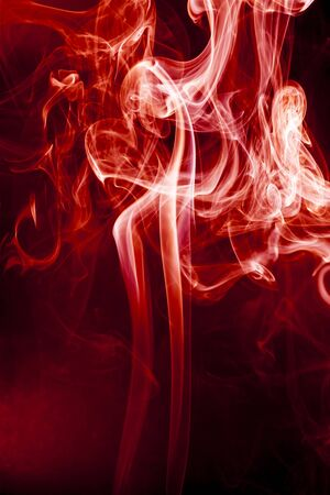 red smoke: Red smoke motion on black background. Stock Photo