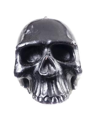 Black skull on a white background. Stock Photo