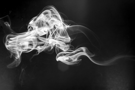 black smoke: White  smoke motion on black background.