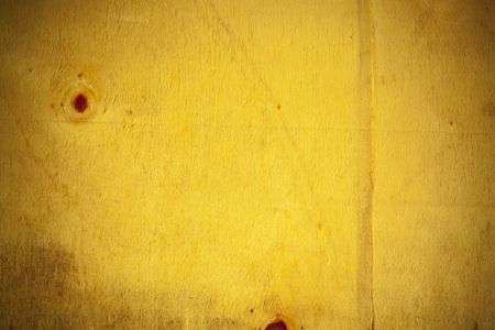board: Yellow wooden board background.