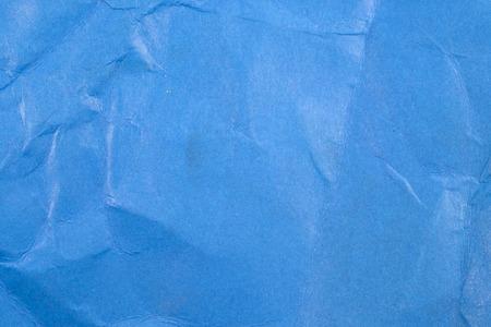 Crumpled blue paper background.