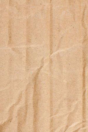 brown: Brown cardboard crumpled texture. Stock Photo