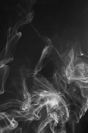 white smoke: White  smoke motion on black background.