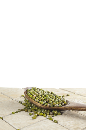 plenty: plenty of mung beans in a wooden spoon