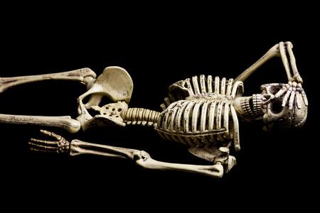 Skeleton model action on black background. Stock Photo
