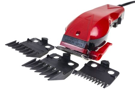 hair clip: Barber red clippers on white background.