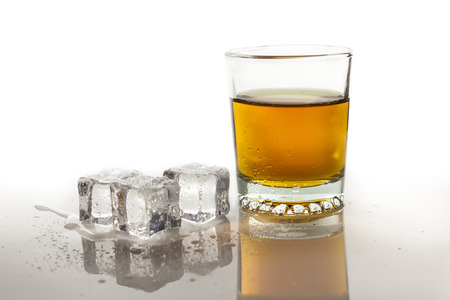 ices: Whiskey in glass with ices Stock Photo