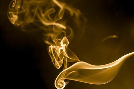 Golden smoke on black background.