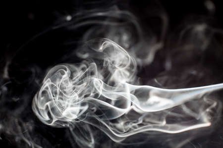 black smoke: Smoke on black background. Stock Photo