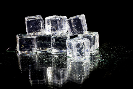 ice crystal: ice cubes on black background. Stock Photo