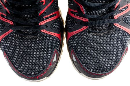 athletic wear: Close up man running shoes on white background.