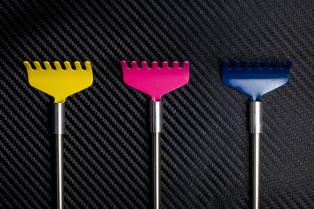 scratcher: Colorful metallic back scratcher.