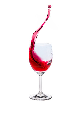 winy: Red wine splash into glass on white background.