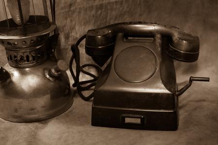 hurricane lamp: Still life Vintage black phone, Old hurricane lamp sepia tone