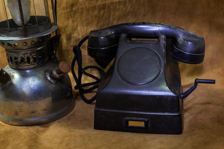 hurricane lamp: Still life Vintage black phone, Old hurricane lamp