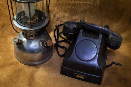 Still life Vintage black phone, Old hurricane lamp