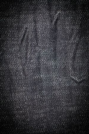 black fabric: Vintage Black Jeans texture background. Stock Photo