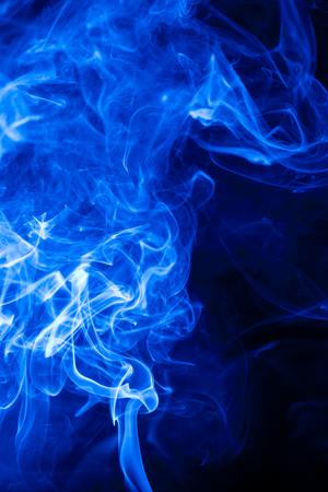Movement blue smoke on black background. Stock Photo