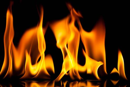 orange inferno: Fire on a black background. Stock Photo