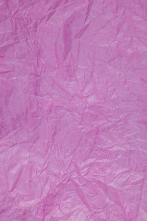 crumpled: Pink crumpled paper surface background.