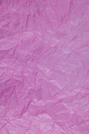 tissue paper art: Pink crumpled paper surface background.