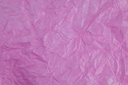 scrunch: Pink crumpled paper surface background.