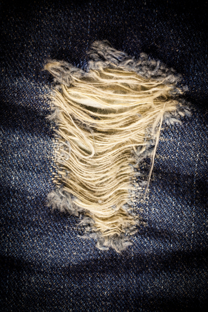 laceration: Vintage Laceration of jeans. Stock Photo