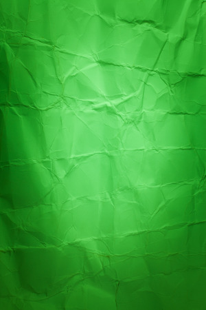 creased: Green cardboard sheet of paper. creased paper background.