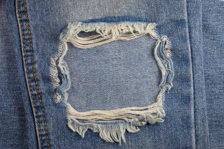 denim jeans: Textures ripped jeans background.