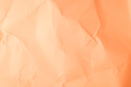 creased: Texture creased orange paper background.