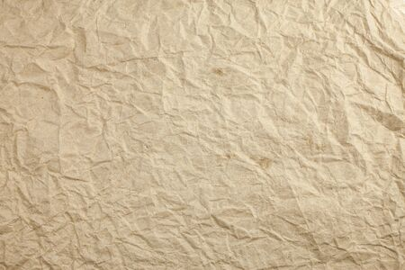 textured paper background: Crumpled eco paper textured background.