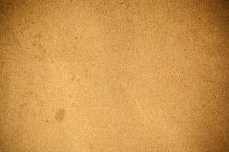 textured paper background: Vintage brown paper textured background.
