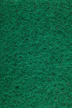 scouring: Green scouring pad background. Stock Photo