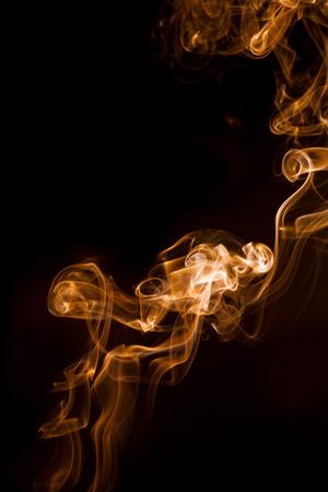 aura energy: Golden smoke on black background.