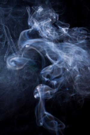 aura energy: White smoke on black background.