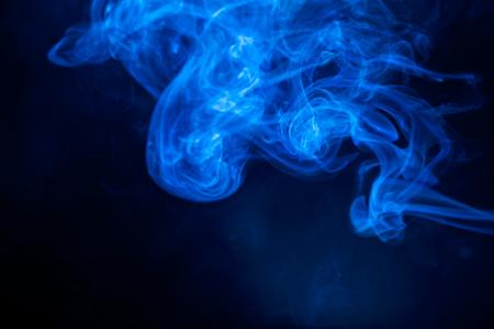 aura energy: Blue smoke on black background. Stock Photo
