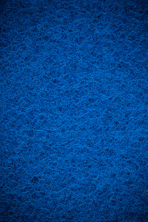 scouring: Blue scouring pad background.
