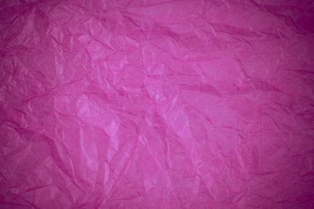 reciclaje papel: Fondo rosado de reciclaje de papel arrugado.