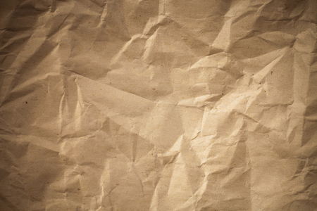 Old crumpled paper,  Brown crumpled paper texture for background.
