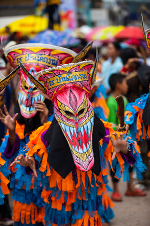ghost mask: LOEI ,THAILAND-JULY 7: Ghost Festival (Phi Ta Khon) The mask procession celebrated  on Buddhist holiday known in Thai asBoon Pra Wate at Loei province,July 7, 2016 Editorial