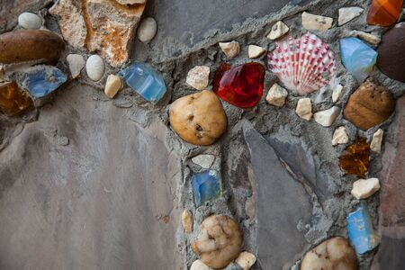 decoratively: Recycled wall tiles stone, mosaic, broken glass, gravel, decoratively recycling reused.