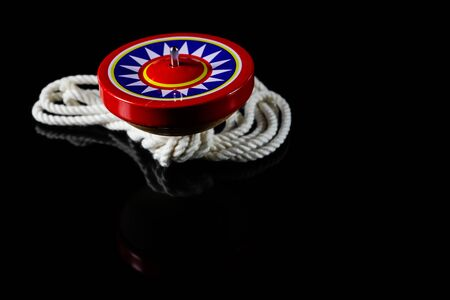 spinning top: Spinning Top, Gyroscopes toy on black background. Stock Photo