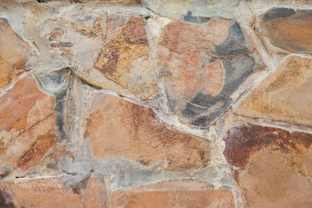 tile cladding: Stone wall background.