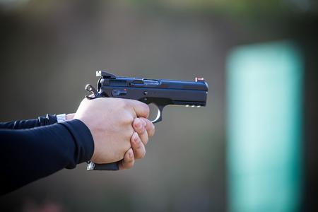 smash: Hand holding a gun.