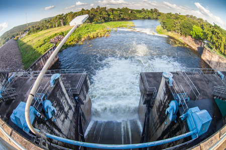 Water flowing from the open sluice gates of dam.