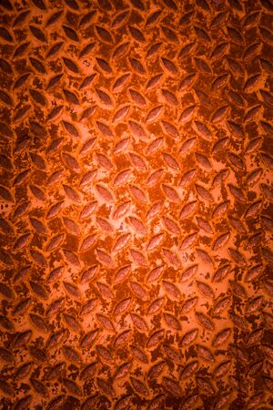 Red metal non slip surface background.