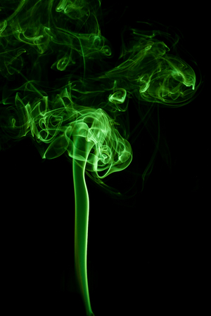 supernatural: Green smoke movement on black background. Stock Photo