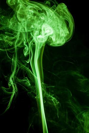 Green smoke movement on black background. Stock Photo