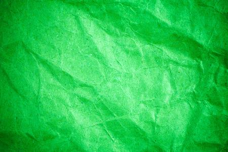 Green vignette crumpled paper.