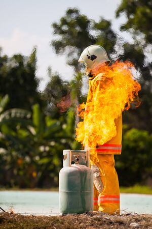 Fireman with fire and suit for protect fire fighter. Stock Photo